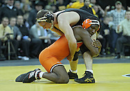 January 07, 2011: Oklahoma State's Chris McNeil and Iowa's Vinnie Wagner during the 184-pound bout in the NCAA wrestling dual between the Oklahoma State Cowboys and the Iowa Hawkeyes at Carver-Hawkeye Arena in Iowa City, Iowa on Saturday, January 7, 2012. Wagner won 4-3.