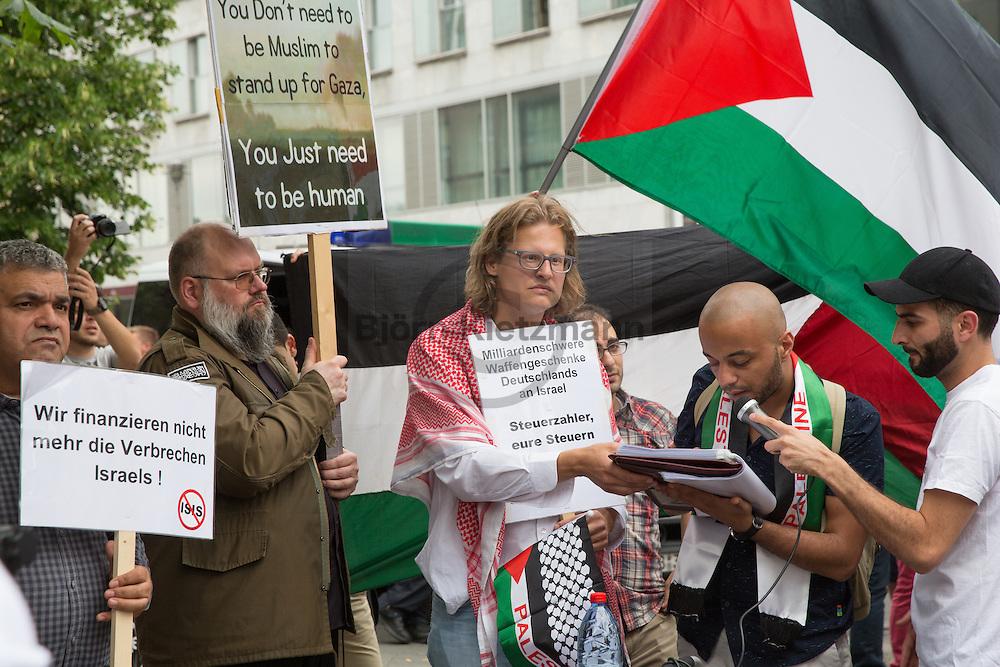 Berlin, Germany - 08.07.2016<br /> <br /> Anti-Israel rally organized by Martin Lejeune, close to the Holocaust Memorial in Berlin. At the rally the names of Palestinians which died during the Gaza war in 2014 was read. The controversial journalist Lejuene, called in the past also the course of Hamas executions as &quot;very social&rdquo;, spoke now of an &quot;Israeli genocide in Gaza&rdquo; in 2014. At the rally, the well-known Islamist Bernard Falk participated. Lejeune call him &quot;Brother Falk&rdquo; during the rally. In some distance a group of counter-demonstrators gathered for a pro-Israel rally. <br /> <br /> <br /> Anti-Israel Kundgebung von Martin Lejeune, nahe des Holocaust-Mahnmals in Berlin-Mitte. Bei der Kundgebung wurden die Namen von Palaestinensern vorgelesen die waehrend des Gaza-Kriegs 2014 starben. Der umstrittene Journalist Lejuene, der Vergangenheit auch dadurch auffiel, dass er den Ablauf von Hamas-Hinrichtungen als &quot;sehr sozial&rdquo; bezeichnete, sprach nun von einem &rdquo;israelischen Voelkermord in Gaza&rdquo; im Jahr 2014. An der Kundgebung nahm auch der bekannte Islamist Bernard Falk teil. Lejeune sprach diesen auf der Kundgebung mit den Worten &rdquo;Bruder Falk&rdquo; an. In etwas Entfernung zur Kundgebung versammelten sich Gegendemonstranten zu einer Pro-Israel Kundgebung.<br /> <br /> Photo: Bjoern Kietzmann