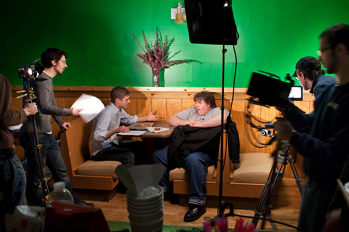 Director Dan Wainio, left, talks to his Sway the Crowd Production team before filming at GGs Bubble Tea.  .