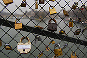 A form of graffiti, thousands of locks people have adorned and locked in place on the Pont des Arts over the Seine.