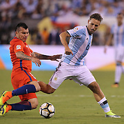 EAST RUTHERFORD, NEW JERSEY - JUNE 26:  Guido Pizarro #6 of Argentina is tackled by Gary Medel #17 of Chile during the Argentina Vs Chile Final match of the Copa America Centenario USA 2016 Tournament at MetLife Stadium on June 26, 2016 in East Rutherford, New Jersey. (Photo by Tim Clayton/Corbis via Getty Images)