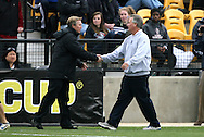 04 December 2011: Stanford head coach Paul Ratcliffe (left) and Duke head coach Robbie Church (right) shake hands before the game. The Stanford University Cardinal defeated the Duke University Blue Devils 1-0 at KSU Soccer Stadium in Kennesaw, Georgia in the NCAA Division I Women's Soccer College Cup Final.
