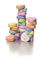 stack of sweethearts candy hearts new love photographed on a white background