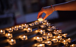 THEMENBILD - URLAUB IN KROATIEN, eine junge Frau zündet eine Kerze an in der Kirche der heiligen Euphemia aufgenommen am 03.07.2014 in Rovinj, Kroatien // a young woman lights a candle in the St. Euphemias Basilica in Rovinj, Croatia on 2014/07/03. EXPA Pictures © 2014, PhotoCredit: EXPA/ JFK