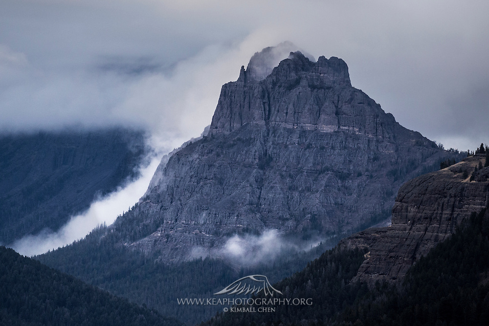 Mist and fog roll down Amphitheater Mountain, along the Absaroka Range, in Yellowstone National Park