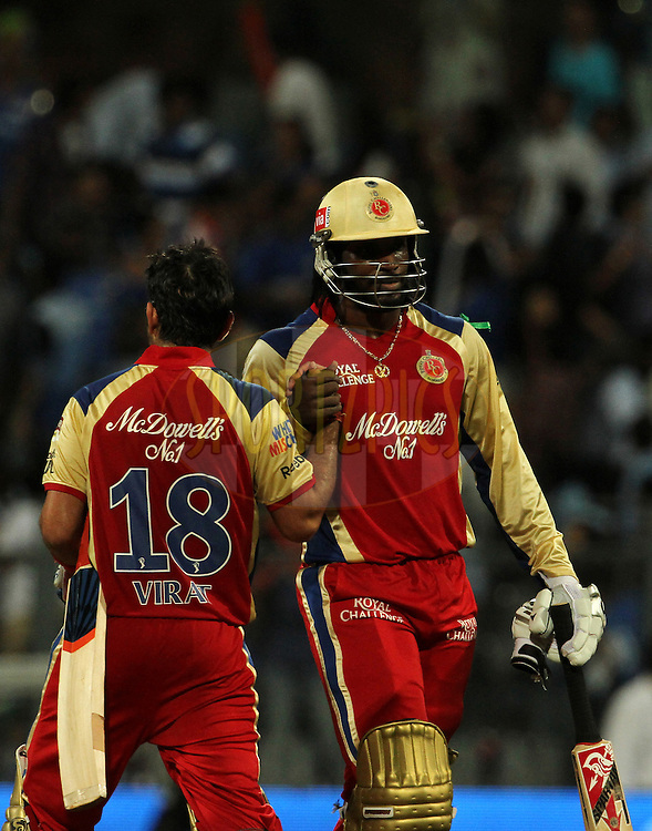 Royal Challengers Bangalore player Chris Gayle and Royal Challengers Bangalore player Virat Kohli celebrates after winning the match 54 of the Indian Premier League ( IPL) 2012  between The Mumbai Indians and the Royal Challengers Banglore held at the Wankhede Stadium in Mumbai on the 9th May 2012..Photo by Vipin Pawar/IPL/SPORTZPICS.