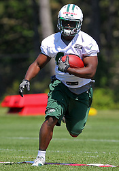 Jun 7, 2012; Florham Park, NJ, USA; New York Jets running back Terrance Ganaway (42) runs with the ball during the New York Jets organized team activities at the Atlantic Health Training Center.