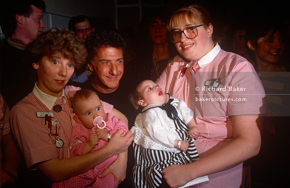 Actor Dustin Hoffman meets nursing staff and patients during a visit to Great Ormond Street Hospital for Children on 5th April 1992 in London, England. Great Ormond Street Hospital is a children's hospital located in the Bloomsbury area of the London Borough of Camden, and a part of Great Ormond Street Hospital for Children NHS Foundation Trust.