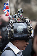 An onlooker with a themed hat outside St. Paul's Cathedral in London as the funeral service for Margaret Thatcher was taking place. The funeral of Baroness Thatcher of Kesteven took place at St. Paul's Cathedral in central London following a procession though the city with full military honours. Margaret Thatcher was Britain's first woman Prime Minister, from her election in 1979 until she resigned in 1990, she died on April 9, 2013.