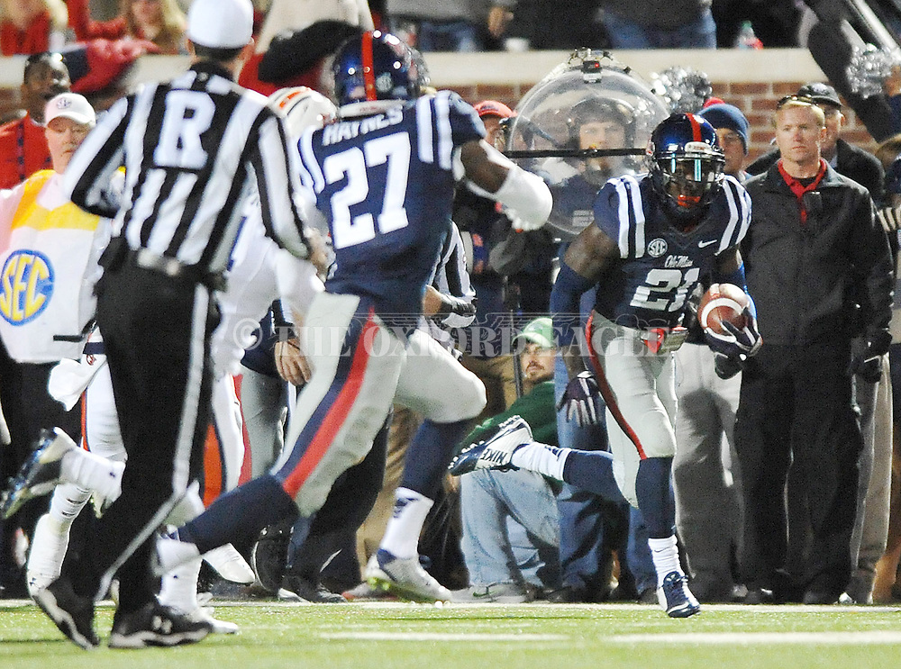 Ole Miss' defensive back Senquez Golson (21) intercepts a pass vs. Auburn at Vaught-Hemingway Stadium in Oxford, Miss. on Saturday, November 1, 2014. (AP Photo/Oxford Eagle, Bruce Newman)
