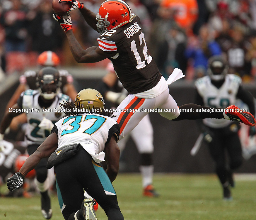 Dec. 1, 2013 - Cleveland, OH, USA - Cleveland wide receiver Josh Gordon, right, grabs a pass in front of Jacksonville safety Johnathan Cyprien at FirstEnergy Stadium on Sunday, Dec. 1, 2013, in Cleveland, Ohio. The Jaguars defeated the Browns, 32-28