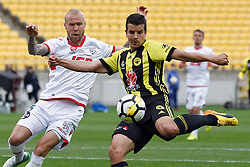 The Phoenix's Andrija Kaluderovic, right, looks to kick the ball as Adelaide United's Taylor Regan  challenges from the left in the A-League football match at Westpac Stadium, Wellington, New Zealand, Sunday, October 08, 2017. Credit:SNPA / Dean Pemberton **NO ARCHIVING**
