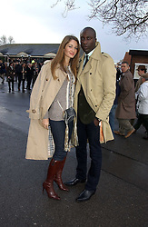 Fashion designer OZWALD BOATENG and his wife GYUNEL at the 50th running of the Hennessy Gold Cup at Newbury Racecourse, Berkshire on 25th November 2006.<br />