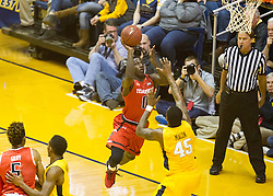 Mar 2, 2016; Morgantown, WV, USA; Texas Tech Red Raiders guard Devaugntah Williams (0) drives baseline and shoots over West Virginia Mountaineers forward Elijah Macon (45) during the first half at the WVU Coliseum. Mandatory Credit: Ben Queen-USA TODAY Sports