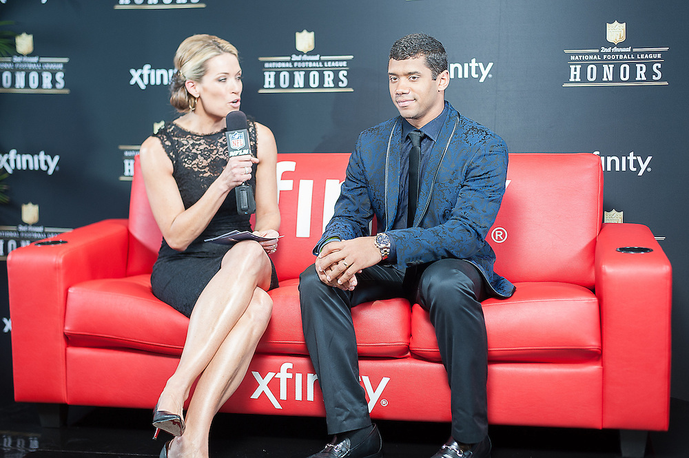 Russell Wilson being interviewed by NFL networks Alex Flanagan at the Mahalia Jackson Theatre NFL Honors in New Orleans, Louisiana on Feb.2 2013.