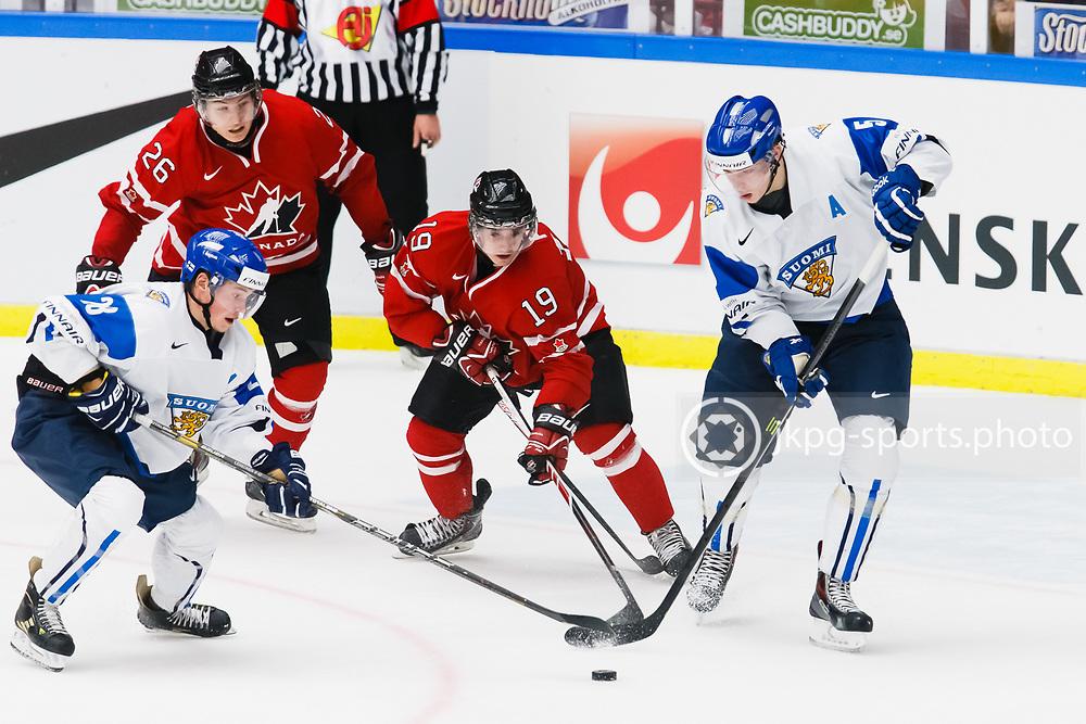 140104 Ishockey, JVM, Semifinal,  Kanada - Finland<br /> Icehockey, Junior World Cup, SF, Canada - Finland.<br /> Artturi Lekhonen, (FIN), Curtis Lazar, (CAN), Nic Petan, (CAN), Rasmus Ristolainen, (FIN).<br /> Endast f&ouml;r redaktionellt bruk.<br /> Editorial use only.<br /> &copy; Daniel Malmberg/Jkpg sports photo