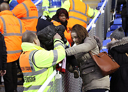 A mother and child are helped away from the crowd trouble in the West Bromwich Albion end of the ground - Mandatory byline: Robbie Stephenson/JMP - 20/02/2016 - FOOTBALL - Madejski Stadium - Reading, England - Reading v West Bromwich Albion - FA Cup Fifth Round