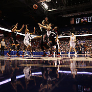 Players rebound during the UConn Vs Cincinnati Quarterfinal Basketball game at the American Women's College Basketball Championships 2015 at Mohegan Sun Arena, Uncasville, Connecticut, USA. 7th March 2015. Photo Tim Clayton