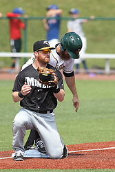 07 June 2015:  Steve Marino gets the throw but it is too late to put the tag on runner Cameron Monger during a Frontier League Baseball game between the Southern Illinois Miners and the Normal CornBelters at Corn Crib Stadium on the campus of Heartland Community College in Normal Illinois