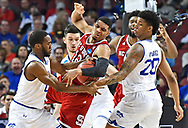 North Carolina State Wolfpack guard Allerik Freeman (12) tries to hold onto the ball between Seton Hall Pirates forward Desi Rodriguez (20) , forward Sandro Mamukelashvili (23) and guard Khadeen Carrington (0) during the second half in the first round of the 2018 NCAA Tournament at INTRUST Bank Arena.