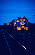 The Blue Train hauled by a diesel engine after leaving Kimberley at dusk.