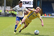 Bury Defender, Craig Jones tackles Millwall On Loan Midfielder, Chris Taylor during the Sky Bet League 1 match between Bury and Millwall at the JD Stadium, Bury, England on 23 April 2016. Photo by Mark Pollitt.