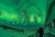 An all-sky aurora display in the early morning hours (between 3 and 4 am) on February 10, 2018, with photographers shooting from the upper deck of the Churchill Northern Studies Centre, Churchill, Manitoba. The display was in a post-sub-storm mode with lots of patchiness slowy drifing across the sky from west to east, but not pulsating in this case. This is looking south. <br /> <br /> This is a single exposure with the 12mm Rokinon full-frame fish-eye lens on the Nikon D750.
