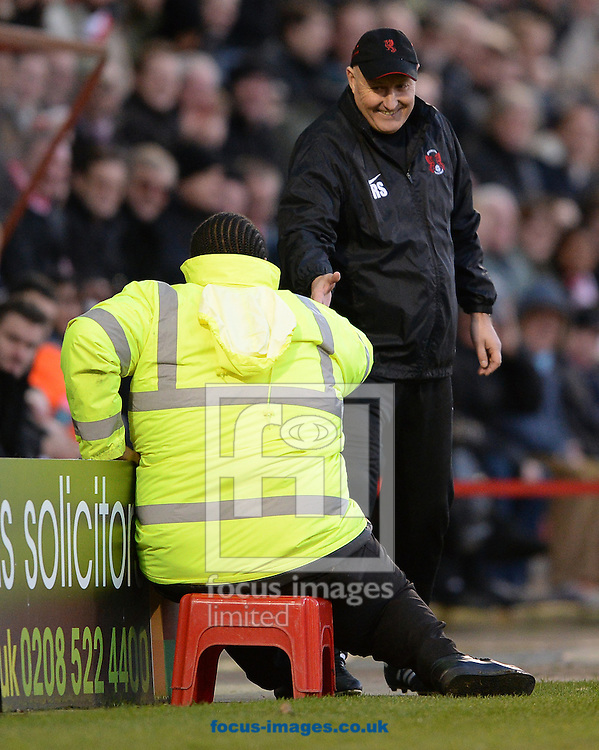 Picture by Andrew Timms/Focus Images Ltd +44 7917 236526<br /> 11/01/2014<br /> Manager of Leyton Orient Russell Slade shakes a stewards hand after he fell off his stool during the Sky Bet League 1 match against Carlisle United at the Matchroom Stadium, London.