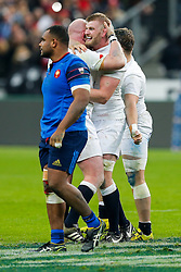 England Lock George Kruis and Prop Dan Cole celebrate after winning the match to complete their Six Nations title with the Grand Slam - Mandatory byline: Rogan Thomson/JMP - 19/03/2016 - RUGBY UNION - Stade de France - Paris, France - France v England - RBS 6 Nations 2016.