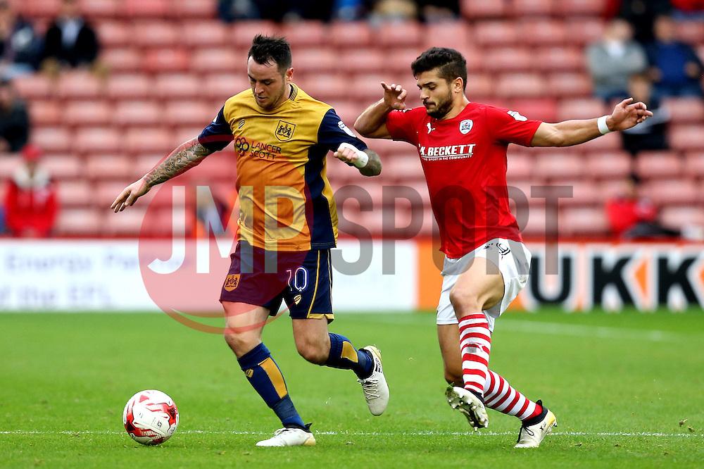Lee Tomlin of Bristol City takes on Sam Morsy of Barnsley - Mandatory by-line: Robbie Stephenson/JMP - 29/10/2016 - FOOTBALL - Oakwell Stadium - Barnsley, England - Barnsley v Bristol City - Sky Bet Championship