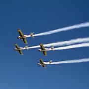 A fly team during an ultralight air show