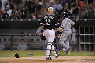CHICAGO - AUGUST 22:  A.J. Pierzynski #12 of the Chicago White Sox stares down Willy Aybar #16 after Aybar collided with Pierzynski at home plate during the game against the Tampa Bay Rays at U.S. Cellular Field in Chicago, Illinois on August 22, 2008.  The Rays defeated the White Sox 9-4.  (Photo by Ron Vesely)
