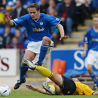 St Johnstone v Raith Rovers....20.09.03<br />Paul Bernard skips the challenge os Shaun Dennis<br /><br />Picture by Graeme Hart<br />Perthshire Picture Agency<br />Tel: 01738 623350 / 07990 594431