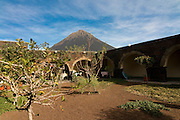 Inner yard of stone house hotel, vulcano in background. Fogo. Cabo Verde. Africa.