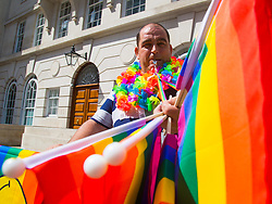 London, July 8th 2017. Thousands of LGBT+ revellers take part in the annual Pride in London parade under the banner #LoveHappensHere. PICTURED: A flag and whistle vendor hopes to do brisk business.