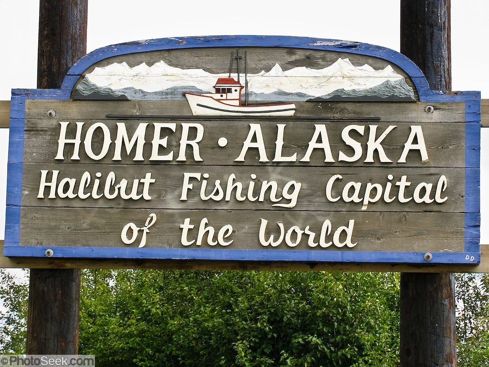 "Homer, Sterling Highway, Kenai Peninsula, Kachemak Bay, Alaska, USA. Homer claims to be the ""halibut fishing capital of the world."" Village nicknames include ""Homer - a quaint little drinking village with a fishing problem"" [bumper sticker] and ""the end of the road."" Homer is the southernmost town on the contiguous Alaska highway system."
