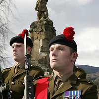 Black Watch Homecoming Parade, Aberfeldy. 02.03.05<br />Sgt Eddie Nicoll (right) and Pte Steven Brown in front of the Black Watch memorial<br />Two guards of a hundred men each from The 1st Battalion The Black Watch marched through Aberfeldy, Perthshire led by the Pipes and Drums also of the 1st Battalion The Black Watch. Aberfeldy is where the 'Companies' of men were mustered in 1667, the dark tartans that the men wore to distinguish them from the 'Red Soldiers' led them to becoming known as 'Freiceadan Dubh' or 'The Black Watch'<br />The Black Watch memorial in Aberfeldy was unveiled on the 14th November 1887 by Gavin - Marquis of Breadlabane.<br />Picture by Graeme Hart.<br />Copyright Perthshire Picture Agency<br />Tel: 01738 623350  Mobile: 07990 594431