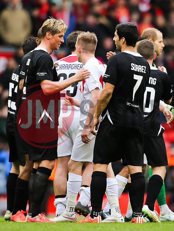 Fernando Torres shakes hands with Luis Suarez after the game - Photo mandatory by-line: Dougie Allward/JMP - Mobile: 07966 386802 - 29/03/2015 - SPORT - Football - Liverpool - Anfield Stadium - Gerrard's Squad v Carragher's Squad - Liverpool FC All stars Game