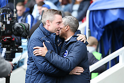 Millwall manager Neil Harris greets Brighton and Hove Albion manager Chris Hughton - Mandatory by-line: Arron Gent/JMP - 17/03/2019 - FOOTBALL - The Den - London, England - Millwall v Brighton and Hove Albion - Emirates FA Cup Quarter Final
