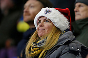 Wimbledon fan in a santa hat during the EFL Sky Bet League 1 match between Tranmere Rovers and AFC Wimbledon at Prenton Park, Birkenhead, England on 21 December 2019.