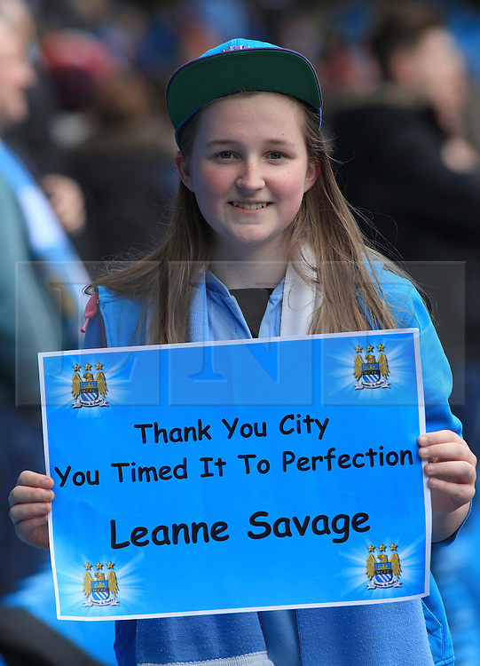 © Licensed to London News Pictures. London, UK. 11/05/2014. London, UK.  A young supporter of Manchester City FC celebrates after the team wins the Barclays Premier League at the Etihad Stadium.Photo credit: LNP