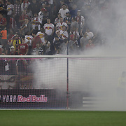 A linesman checks out the netting as smoke from a flare engulfs the goalmouth during the New York Red Bulls V New England Revolution, Major League Soccer regular season match at Red Bull Arena, Harrison, New Jersey. USA. 5th October 2013. Photo Tim Clayton