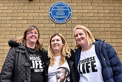© Licensed to London News Pictures. 15/04/2018. BUSHEY, UK.  (L to R) Jane Cronk, Toni Parkins and Jayne Apps, fans from Bushey, pose in front of a blue plaque commemorating the life of singer George Michael which has been unveiled at Bushey Meads school in Bushey, north west London.  George Michael was a student at the school for two years prior to finding success with Andrew Ridgeley in the group Wham! before moving on to a successful solo career.   The blue plaque was made possible by the George Michael Appreciation Society and the Heritage Foundation.  Photo credit: Stephen Chung/LNP