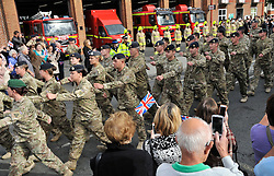 © Licensed to London News Pictures. 4 October 2013. Didcot Oxfordshire. Taking the salute at the Fire Station. Princess Anne awarded campaign medals to 11 EOD Bomb Disposal regiment today in Didcot Oxfordshire. Photo credit : MarkHemsworth/LNP