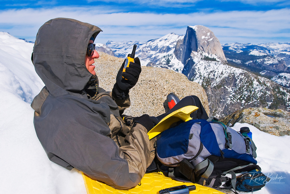Backcountry skier (with radio) and Half Dome from Glacier Point, Yosemite National Park, California