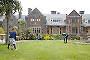Playing croquet in the garden at Pickwell Manor. From left to right: Millie-grace Elliott (8), Liza Baker (9), Molly Elliott (10), Zac Baker (11). Pickwell Manor, Georgeham, North Devon, UK.<br /> CREDIT: Vanessa Berberian for The Wall Street Journal<br /> HOUSESHARE