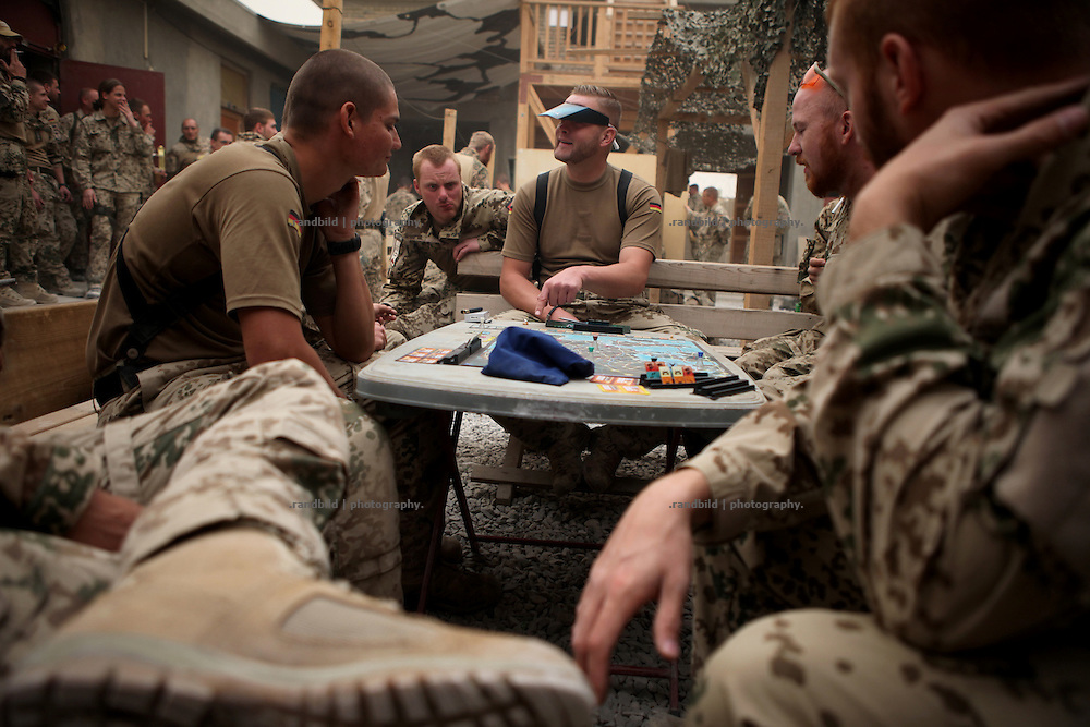 Soldiers play a table game waiting for new orders inside a District Headquarters near Nawabad, which is located inside the District Headquarters of the afghan Police. In late October 2011 Kunduz based 3.Task Force started a several days operation in and around Nawabad (District Chahar Darah), west of Kunduz, northern Afghanistan. During the Operation Orpheus about 100 german infantery soldiers rolled out for patrols through the town and surrounding areas, which were expected as a retreat zone of insurgents.