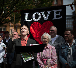 "© Licensed to London News Pictures . 16/08/2015 . Manchester , UK . Actor MAXINE PEAKE amongst people reading an account of the "" Peterloo "" massacre at a memorial at the site of St Peter's Field , where fifteen people were killed during a cavalry charge on a democracy protest , 196 years ago (16th August 1819) . Photo credit : Joel Goodman/LNP"