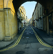 View under Trim Bridge of cobbled Trim Street, Bath, Somerset, England