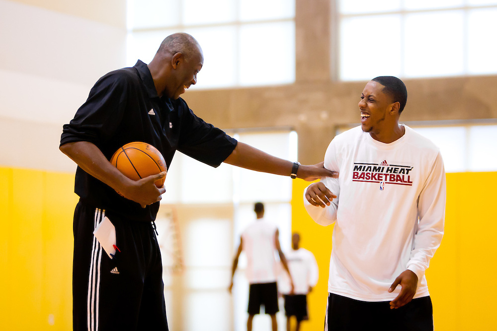 MIAMI, FL -- January 29, 2012 -- Miami guard Mario Chalmers, right, shares a laugh in the Heat's practice gym with assistant coach Bob McAdoo prior to their 97-93 win over the Chicago Bulls at American Airlines Arena in Miami, Fla., on Sunday, January 29, 2012.  (Chip Litherland for ESPN the Magazine)